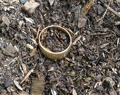 It's easy to see the gold wedding band from up close.