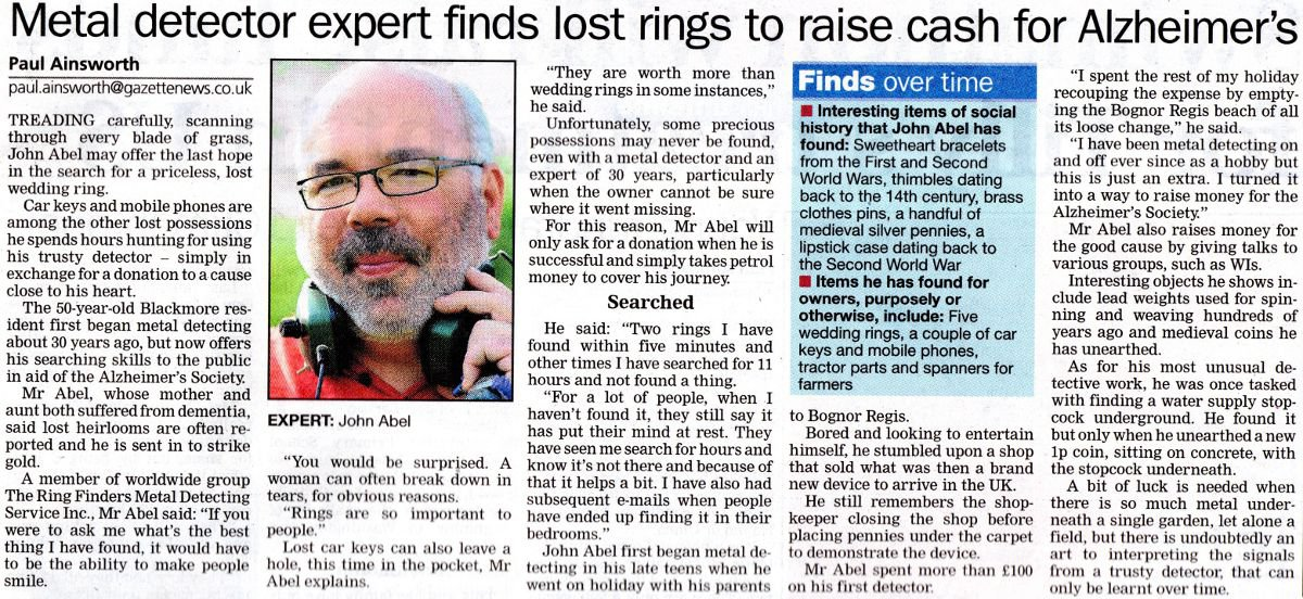 Metal detector expert finds lost rings to raise cash for Alzheimer's newspaper clipping
