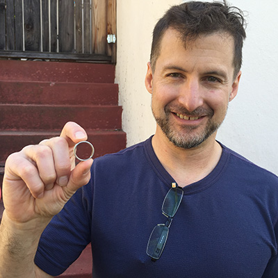 Phil with his lost ring, found in his Oakland back yard